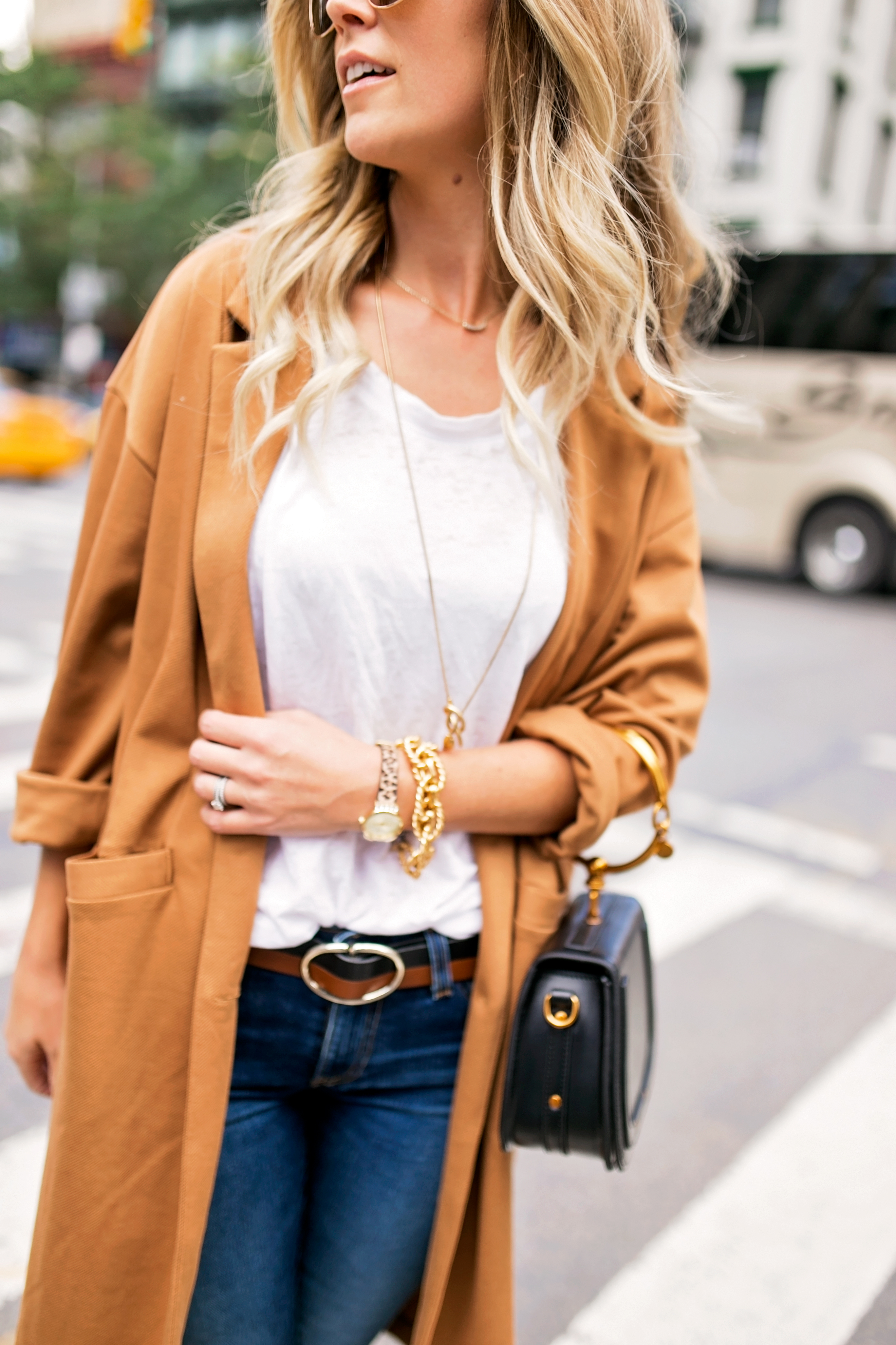 white tee and long necklace
