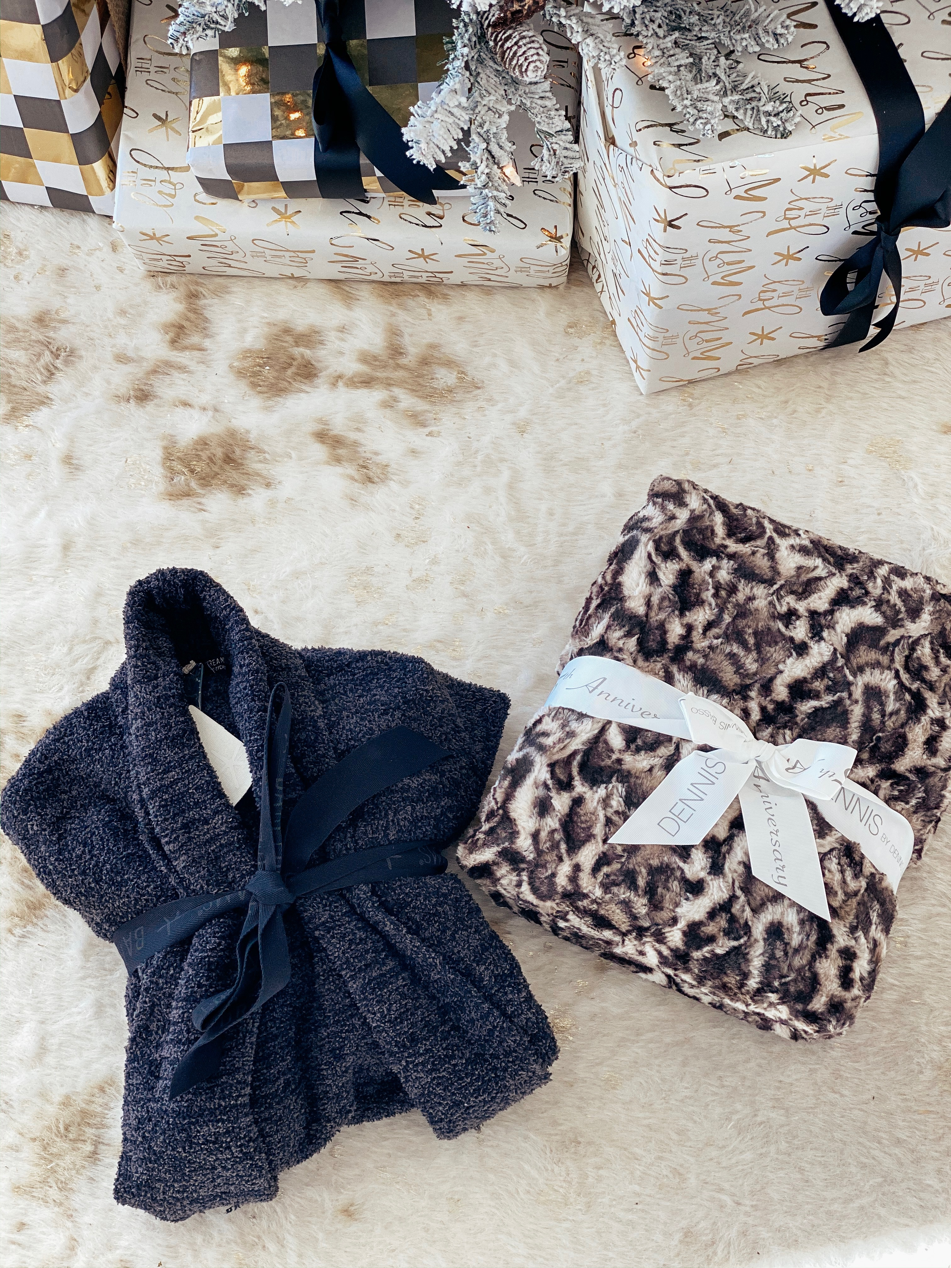 The coziest gifts for the holidays! Barefoot dreams cardigan and fur blankets.